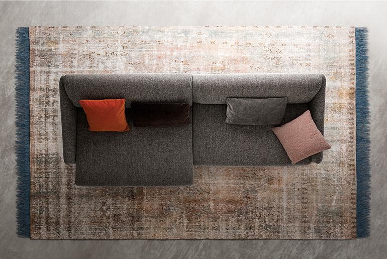 Asolo sofa design Emilio Nanni with forward movement of the seat cushion