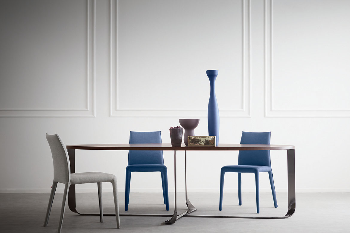eliptic confluence table design Xavier Lust and emi chairs in fabric cover