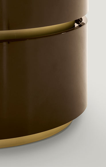 detail of dedalo round casegood in brown lacquer and spacer gold