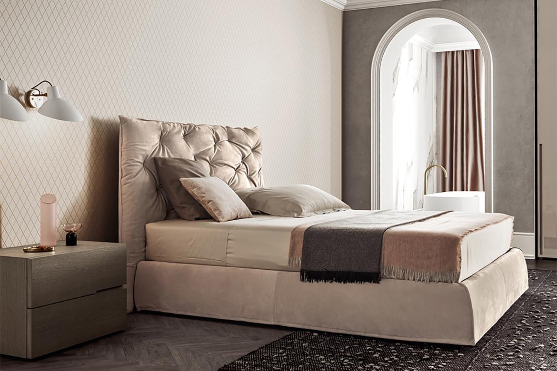 letto imbottito con testiera maxi , comodino in legno pianca