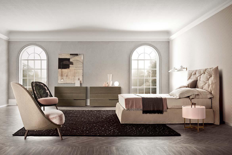 Impunto uplosthered bed, Calatea armchair, segno casegood, dedalo drawer unit Pianca