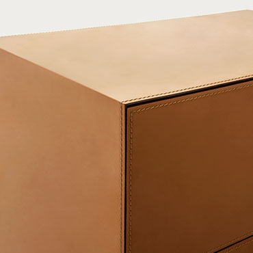 detail of hard leather cover casegood norma Pianca