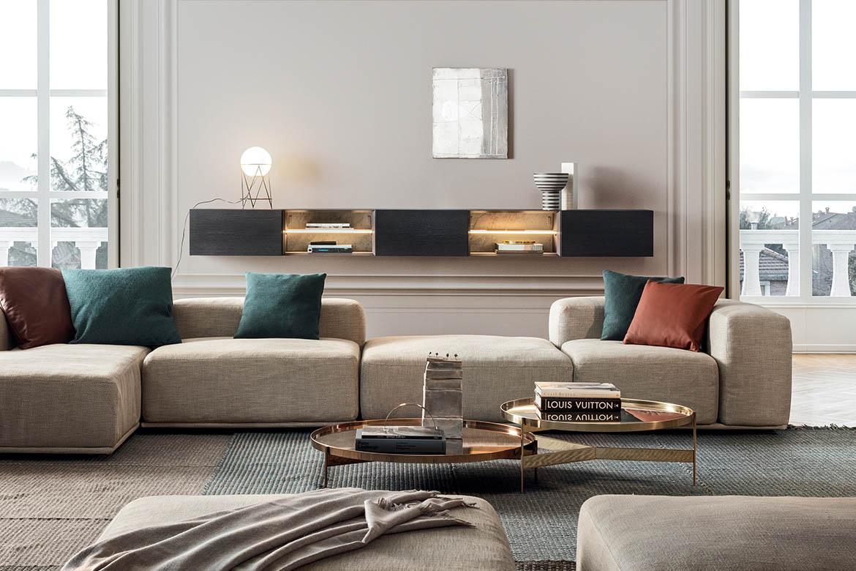 divano componibile delano in tessuto grigio con pianale, tavolino abaco in metallo color bronzo e oro pianca