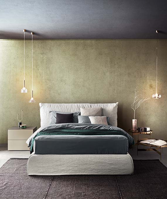 modern italian uphlostered bed piumotto with storage base and abaco coffetable