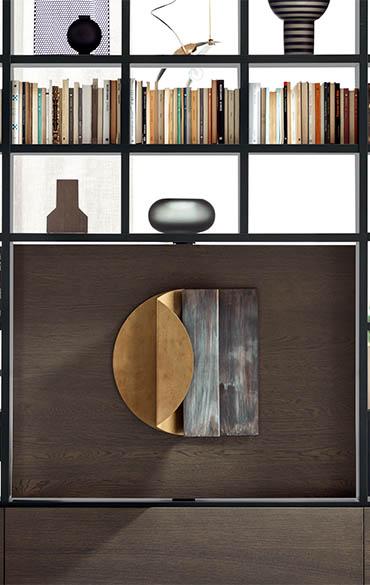 libreria con vano girevole porta tv o scultura