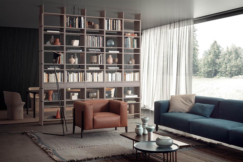 libreria bifacciale in legno colore grigio nuvola, poltrona all-in design cmp design studio tavolini componibili 1+1 pianca