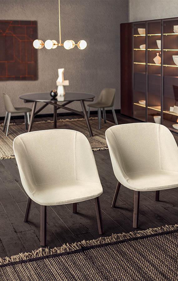 poltrona con gambe in legno massello esse lounge design philippe tabet per pianca